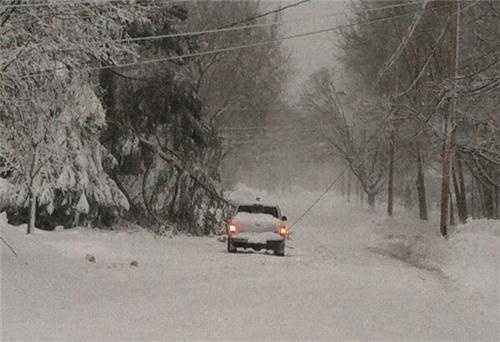 In Hingham: Central Street near police station blocked by tree on live wire.