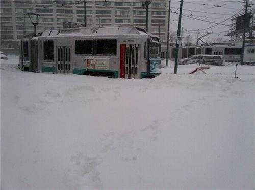 A Green Line trolley snowed in at the Lechmere train yard.
