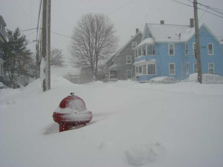 Snow drifts from plowing of Charles Street in Malden nearly buried this fire hydrant