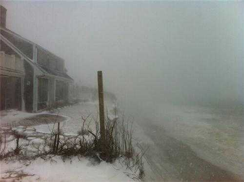 House on Baxter Road in Nantucket now very close to the bluff.