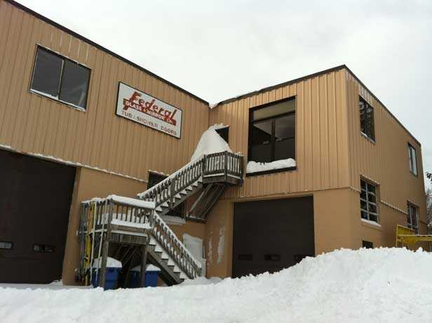 At Federal Glass in Framingham, an estimated 30 inches of snow surrounds the building.