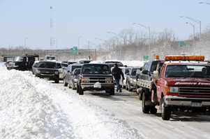 Traffic is backed up on the Long Island Expressway just west of Exit 59 Ocean Avenue as payloaders clear snow from the road after a storm, Saturday, Feb. 9, 2013, in Ronkonkoma , N.Y.