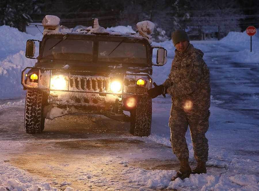 The first National Guard convoy carrying evecuees arrives at the Furnace Brook Middle Schoolin Marshfield in Feburary 2013