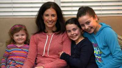 Lori Stalker, 41, survived a brain aneurism while at a gym class with her 12 year-old daughter. Lori and her daughters (from left): Kate (3), Sophia (9), and Olivia (12).