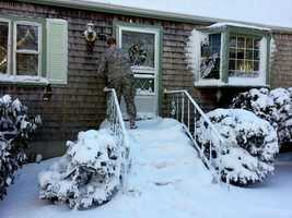 Sgt. Christopher Graham knocks on a home in Marshfield, performing a health and wellness check.