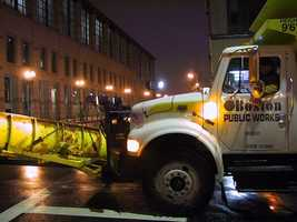 A snowplow in Boston at the beginning of the storm