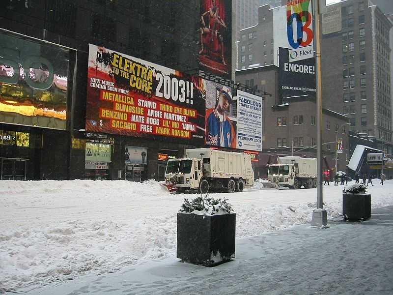 Times Square, New York City, during the February 2003 blizzard. Photo shows the city garbage collection trucks outfitted with snow plows and scoops.