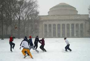 A group from the Cambridge Community Fellowship Church plays football in a blowing snowstorm in Killian Court at the Massachusetts Institute of Technology on Feb. 17, 2003.