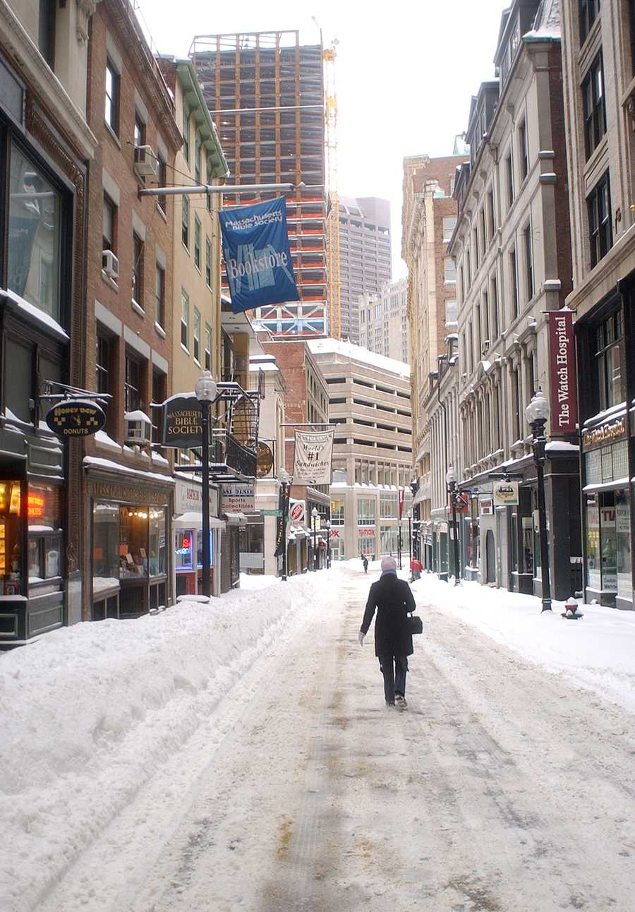 A pedestrian walks down snow covered Bromfield Street in downtown Boston Tuesday, Feb. 18, 2003 after a snowstorm dumped 27.6 inches of snow in the Boston area.