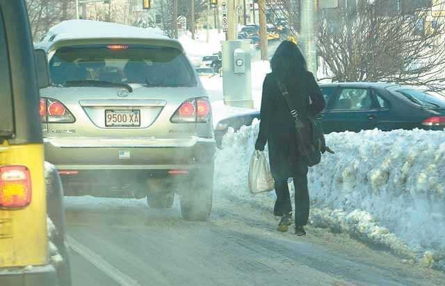 Sharing the road with cars before the cleanup is complete on the South Shore