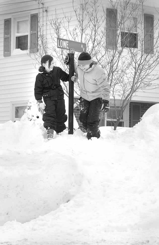 The snowbanks almost reached the street signs in Stoughton