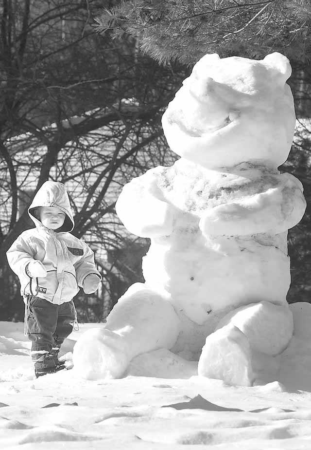 The snowman dwarfs the child on the South Shore