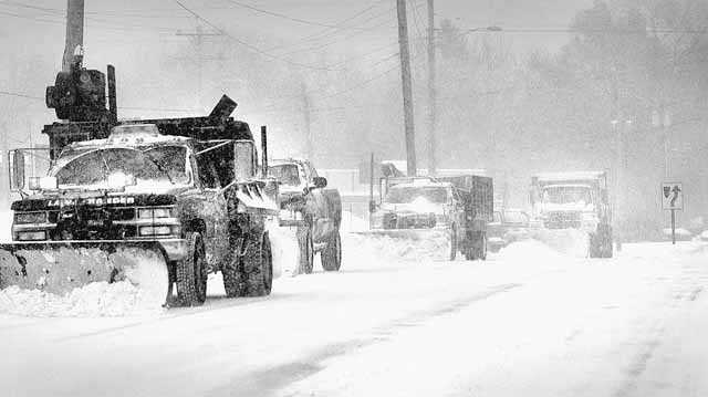 Plowing during the storm along the South Shore