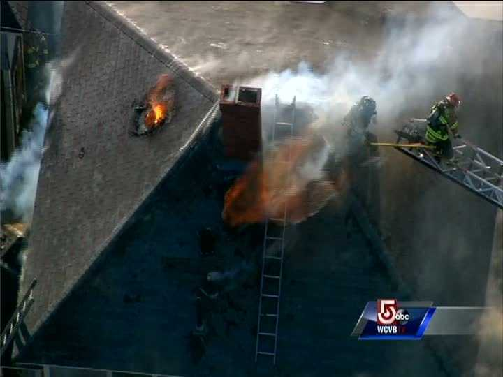 Firefighters were battling a large house fire on Ames Ave at Circuit Ave. in Marshfield Wednesday afternoon.