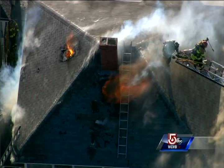 The fire fighters were just inches away from the flames that were shooting from the roof of the multi-story home.
