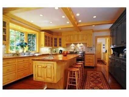 The gourmet kitchen features a Viking stove.