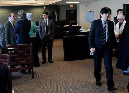 Tomo Fujita, far right, the father of Nathaniel Fujita, and Malcolm Astley, far left, the father of Lauren Astley, leave the courtroom.