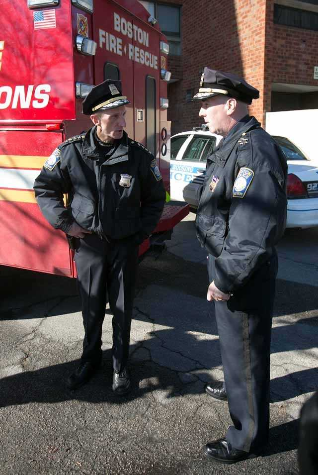 Boston Police Superintendent in Chief Dan Linskey, right, speaks with Superintendent William Evans, left, outside the Roslyn Apartments at 1 Cliffmont St in Roslindale after 2 residents died unexpectedly and a 3rd fell ill on Thursday.