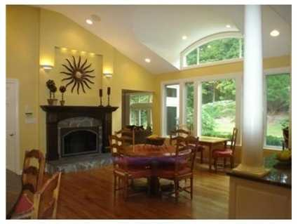 The family rooms has custom built-ins.