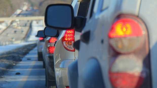Car taillights stuck in traffic.JPG