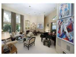 The home abuts The Country Club golf course in the estate area of Brookline.