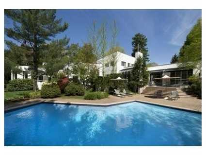 It also features masterfully landscaped grounds with an in-ground pool.