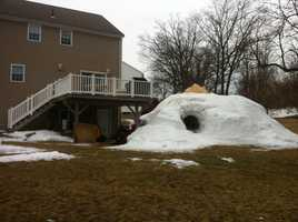 "Michael J. Kozlowski's igloo is 12 feet high. He calls it ""Club Ice"""