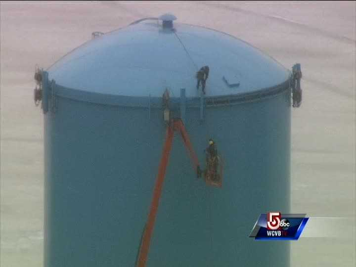 The workers had been doing work on a cell phone tower located on top of the water tower.
