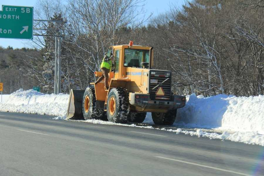 Bulldozers and dump trucks were used to pick up snow along the highways and move it to a safer place.