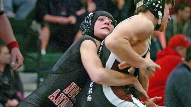 Carver's Aidan McGrath, right, wrestles North Andover's Danielle Coughlin for first place in the 106-pound category at the Marshfield wrestling tournament on Wednesday, Dec. 2.