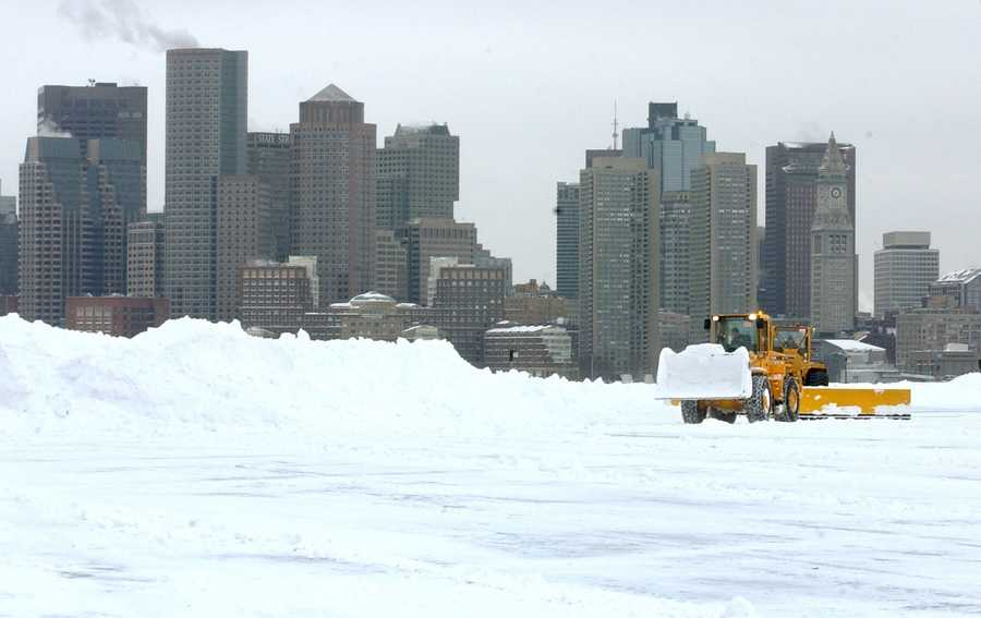 The historical and record-breaking East Coast snowstorm covered the major east coast cities under 15 to 30 inches of snow.Snow is cleared from the south cargo area of Logan Airport with Boston as a backdrop following a blizzard Tuesday, Feb. 18, 2003 in Boston.