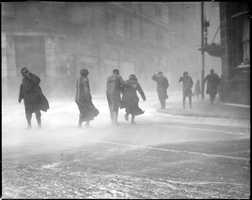 Pictured here are Bostonians battling the wind and snow in Downtown Boston in February 1920.