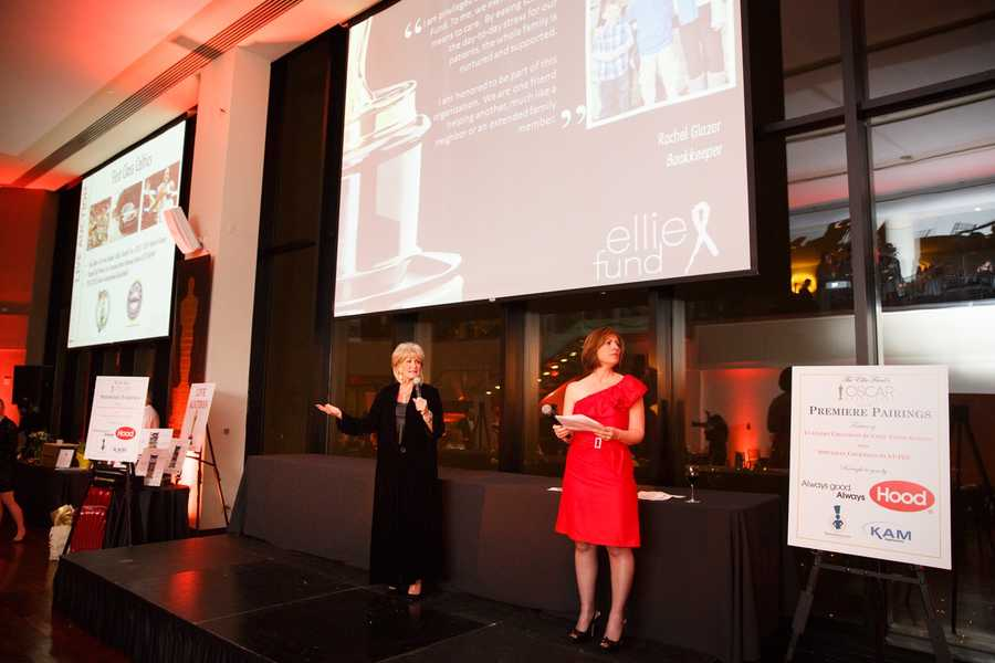 Susan Wornick and Kelley Tuthill conduct the auction.