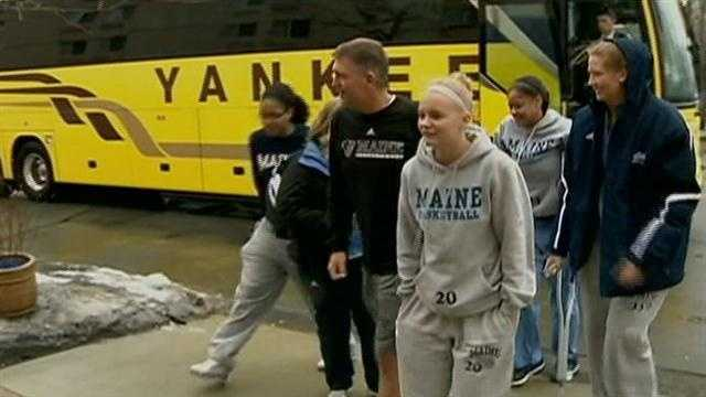 A bus carrying the University of Maine women's basketball team ran off a highway north of Boston, leaving a player with a broken hand, the head coach with minor facial cuts and the driver seriously injured.
