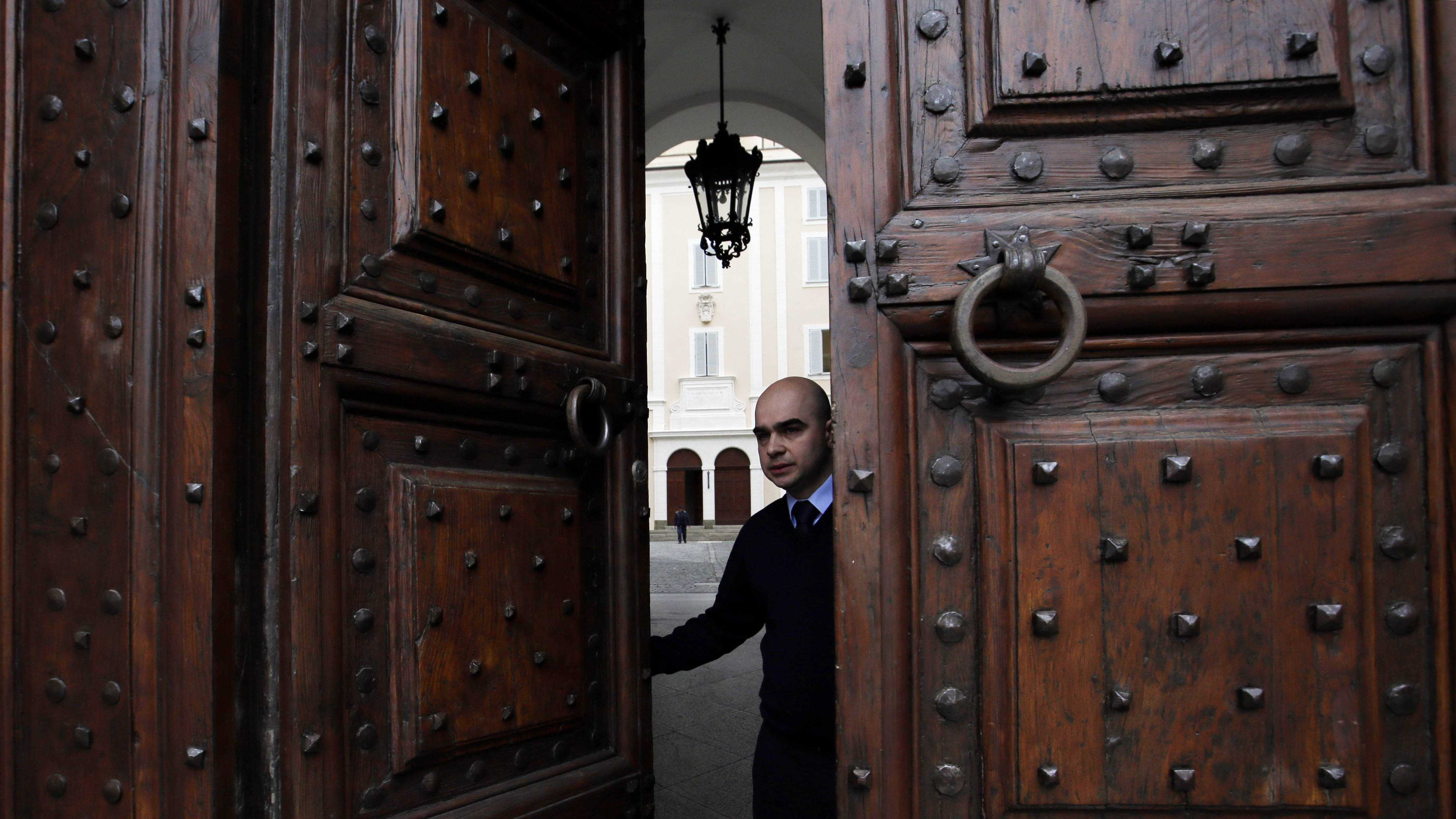 Vatican usher closes the main door of pope's summer residence of Castel Gandolfo