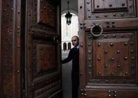 Vatican usher closes the main door of pope's summer residence of Castel Gandolfo