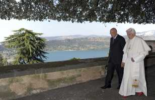 Pope Benedict XVI, right, and Italian President Giorgio Napolitano walk in the garden of Castel Gandolfo prior to a concert of the West Eastern Divan Orchestra on Wednesday, July 11, 2012.