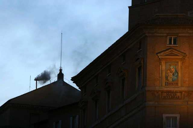 Black smoke rises from the chimney of the Sistine Chapel, at the Vatican, April 18, 2005.Black smoke signals that the cardinals sequestered inside for the first papal conclave of the new millennium held their first vote but failed to elect a new leader.