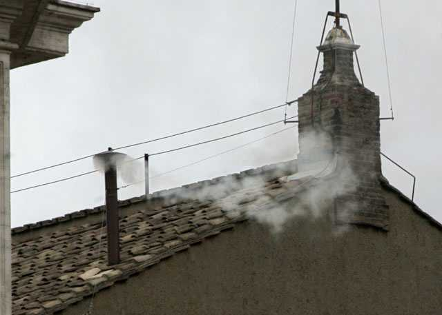 White smoke billows from the chimney atop the Sistine Chapel, at the Vatican, April 19, 2005 to announce the election of Pope Benedict XVI.