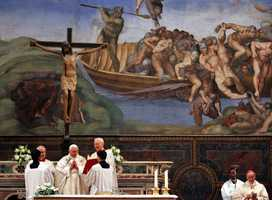 Pope Benedict XVI, center, prays during a baptizing ceremony in the Sistine Chapel at the Vatican, Jan. 7, 2007. Benedict XVI baptized 13 newborns continuing a tradition of Pope John Paul II.