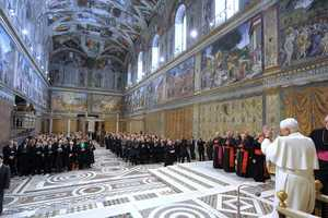 In this picture made available by the Vatican newspaper Osservatore Romano, Pope Benedict XVI greets artists, actors and musicians in the Sistine Chapel at the Vatican, Nov. 21, 2009.