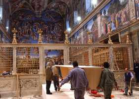 In this picture released by the Vatican newspaper L'Osservatore Romano, April 15, 2005, workers prepare the Sistine Chapel for the Vatican conclave that elected Pope Benedict XVI.