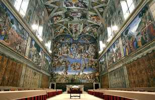 In this Saturday, April 16, 2005 photo, tables and chairs line the Sistine Chapel at the Vatican in preparation for the conclave that elected Pope Benedict XVI.