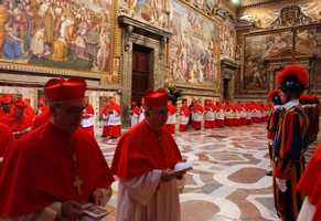 In this photo released by the Vatican paper L'Osservatore Romano, Cardinals walk in procession to the Sistine Chapel at the Vatican,April 18, 2005, at the begining of the conclave that elected Pope Benedict XVI.