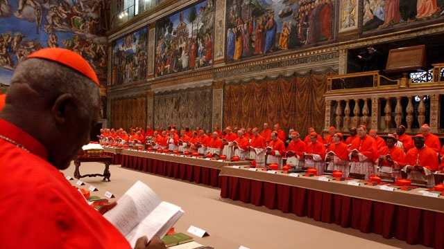 In this photo released by the Vatican paper L'Osservatore Romano, Cardinal Christian Wiyghan Tumi of Cameroun joins fellow cardinals in prayer inside the Sistine Chapel at the Vatican, April 18, 2005, at the beginning of the conclave that elected Pope Benedict XVI.