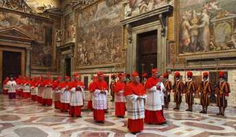 This April 18, 2005 photo made available by the Vatican paper L'Osservatore Romano shows Cardinals walking in procession to the Sistine Chapel at the Vatican for the conclave to elect the successor of late Pope John Paul II.