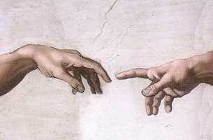 The iconic image of the Hand of God giving life to Adam