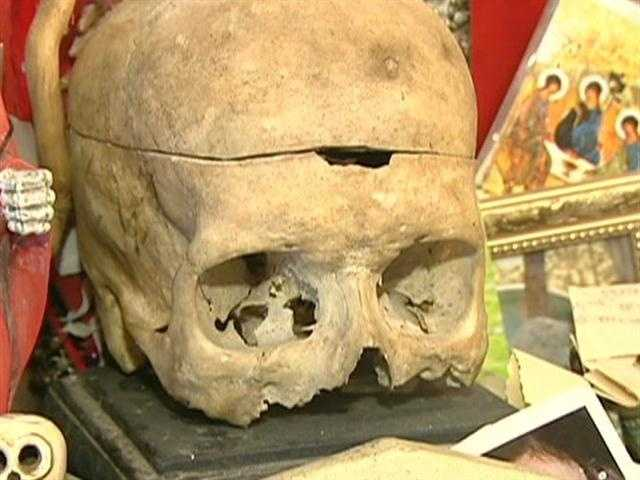 The witches' altar is presided over by a real human skull.