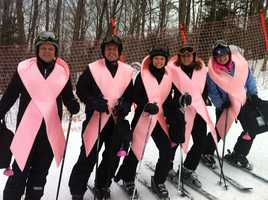 All participants race in costume with a soft-sided briefcase in hand. This is the Pink Ribbons team.
