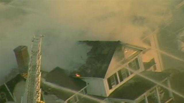 Crews battled a large, smoky fire in a home on Dover Road in Westwood on Monday.